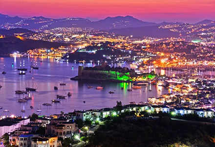 View of Bodrum harbor and Castle of St. Peter by night. Turkish Riviera