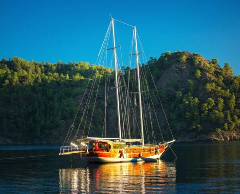 Traditional gulet anchored in the calm bay of Skopea Limani,