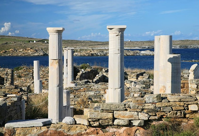 View-overlooking-Cleopatras-House-and-the-ruins-of-Delos-towards-the-shore.-The-Greek-island-of-Delos-is-one-of-the-most-important-historical-and-archaeological-sites-in-G